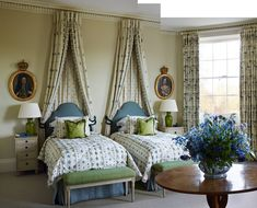 Fleur de Lis' fabric by Chelsea Textiles has been used for the beds in a guest room.