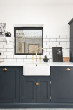 Sink run painted in Pantry Blue with our aged brass Ionian tap