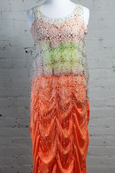This Mardi Gras inspired outfit will have you dancing for days. This multicolored pastel #dolceandgabanna tanktop paired with a #calypso orange maxi tiered skirt and crystal weaved see through top is perfect for dancing.  All of these items are on sale now in our Ebay store: http://stores.ebay.com/1roboshipping   #womensfashion #mardigras #summer #spring #dancing #crystals #pastels #orange #multicolor #forsale #ebay #fashion