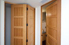 This is a bamboo door that uses a stile and rail construction with bamboo flat panels.  Shown as a bifold door and a bedroom door.