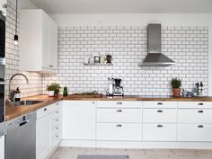 metro white tile kitchen inspiration wood countertop
