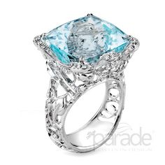 from Parade Design Parade's vintage-inspired design is anything but your basic ring. Milgrain etched scrolls and leaves curl and climb with diamonds toward a show-stopping 21.03 carat cushion-cut aquamarine