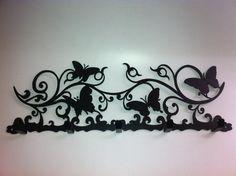 Décor art artistic iron metal wall coat hat clothes bag rack hooks 5 hangers. $30.77, via Etsy.