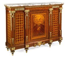 Maison E. Delmas late 19th/early 20th century A large and fine Louis XVI style gilt-bronze mounted kingwood, satiné and fruitwood marquetry side cabinet, Paris, Sotheby's