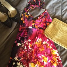 Express floral halter dress Comfy dress to wear to a picnic or over a bathing suit. Has been worn, so there is some fading and pilling. Express Dresses