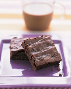 To make these brownies lower in fat and calories (but still moist and fudgy), we replaced some of the eggs and butter with prune puree.