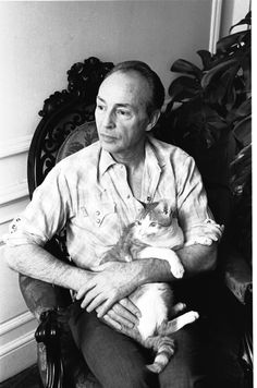 New York City Ballet Master George Balanchine at home with his cat Mourka (New York)