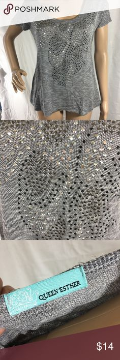 """Embellished flare shirt Very soft with pretty silver studs. Has a flare fit. Stretchy. Rayon/poly blend. In excellent condition! Measures 16"""" pit to pit and is 22"""" long Tops Tees - Short Sleeve"""