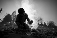 A child from #Syria tries to start a fire on a cold winter's day in Harmanli #Refugee Reception Center. December 12, 2013 Photo: Dobrin Kashavelov
