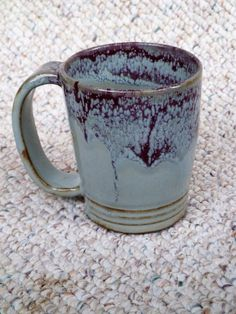 "Stoneware Mug by Shelley Duncan, glazed in cone 6 ""Powder blue"" with rim dipped in ""Burgundy"""