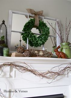 Hymns and Verses: My Spring Mantel-  I like all the natural elements and the cloche....my kinda mantel...if I had one:/ love all the colors:)