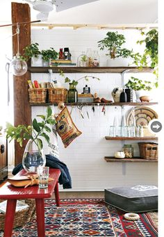 entryway white with wood accents, wood shelves, bench, lots of plants