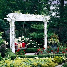 Petite Pergola A pergola doesn't have to be large to make a statement. Tucked amid a well-manicured formal garden, this triangular pergola is a striking focal point--small but nicely detailed, with a classic white painted finish. The swinging bench makes it all the more inviting and versatile.