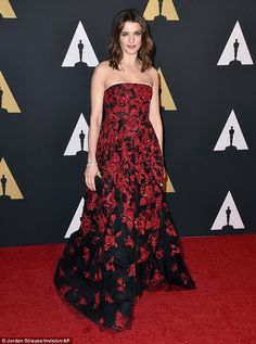 Drama!  A stunning sight: Rachel showed some cleavage in a strapless black gown with red sequined embellishment.  Oscar de la Renta gown.