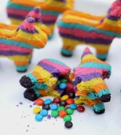 Cinqo de Mayo Pinata Cookies... These look hard to make, but if you showed up to a party with them... you would definitely have the star dessert.