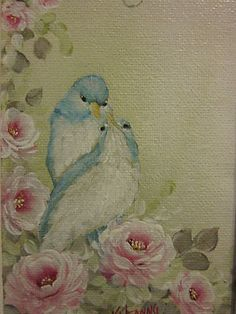 Framed painting of bluebirds and pink roses.