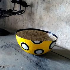 Handcrafted decorative bowl in bright canary yellow made from