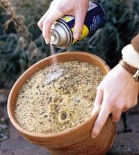 Flower pot, sand, WD-40 and garden tools.  Add WD-40 until the sand is moist.  Clean all excess dirt from garden tools, shove into sand, place in a dry area.  This will keep your garden tools nice through winter or long periods between gardening.
