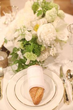 baguettes at each place setting for an elegant, classic wedding. See the Access Hollywood segment right here: http://www.stylemepretty.com/2013/05/03/style-me-pretty-on-access-hollywood/ flowers by http://flowerwild.com/, cakes and treats by http://www.sweetandsaucyshop.com/, linens by http://linens.latavolalinen.com/