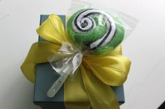 cute little topper for a baby gift  (lollipop made out of two baby wash cloths and a baby spoon)