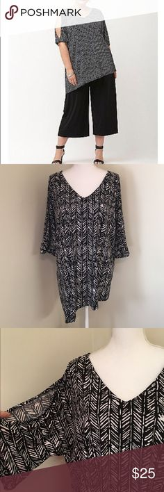 """Lane Bryant Cold Shoulder Tunic This pretty top has open shoulders, loose elastic at the end of the 3/4 length sleeves, and a hi-lo hem. It has a black and white Aztec print throughout and a v-neck in both the back and front. Material: 95 polyester and 5% spandex. It is stretchy. Bust measures 52"""", waist 51"""", and hips 56"""". The longer side measures 31"""" in length and the shorter 26.5"""". It is from the Lane Bryant Simply Chic Collection, is size 18/20, and is brand new with tags. Lane Bryant…"""