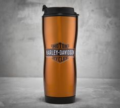 While you gear up for your sunrise ride, this 16 oz., stainless steel and plastic, orange to-go mug with Bar & Shield logo will keep your joe hot. | Harley-Davidson Trademark Travel Mug