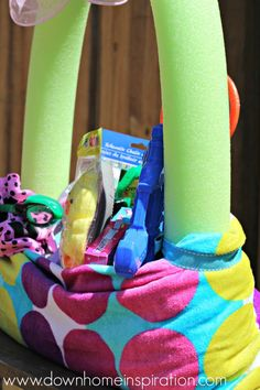 Make a fun Easter Basket Using a Beach Towel and Pool Noodle - Down Home Inspiration