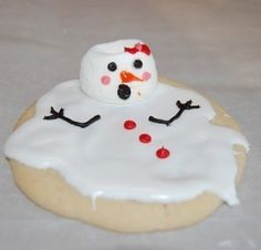 Cookies with melted white icing and a marshmallow with piped details.  Gotta do this with my granddaughter.