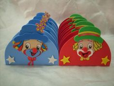 cute clown heads in fun felt that could be for birthday party invitations, or favors for a party