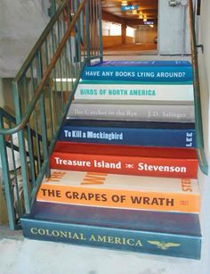 Books painted on concrete stairs (library entrance)