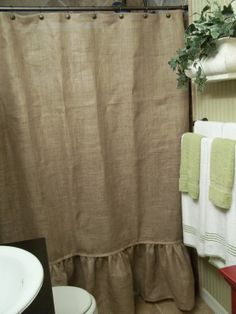 No crazy about the ruffles, but the burlap is nice. Ruffled Bottom Burlap Shower Curtain by SimplyFrenchMarket on Etsy – also have burlap curtain panels  Ruffle is a big NO!