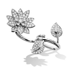 Lotus Between the Finger Ring - White Gold, Diamond - The Lotus collection features the Chinese symbol of wisdom and prosperity in a delightfully rendered nature theme.  As ingenious as it is elegant, this ring can be worn with leaves and flower between the fingers or stacked together.  Van Cleef & Arpels has introduced a highly unique way of wearing a ring: nestled weightlessly between the fingers… - $32,600.