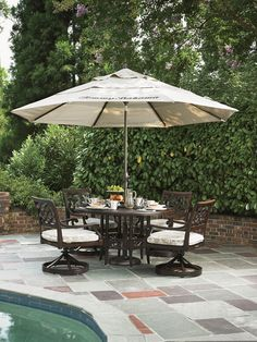 Black Sands Outdoor Round Dining Table and Outdoor Swivel Chair Set