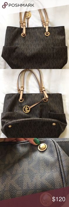 Authentic Micheal Kors bag Micheal Kors bag in spotless condition. The only Marks on this bag is on the bottom (pictured) Michael Kors Bags Totes