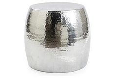 The hammered texture of the gleaming aluminum adds a modern finesse to the classic garden stool.