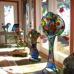 Several colouful fused glass and steel sculptures to accent a gorgeous room.