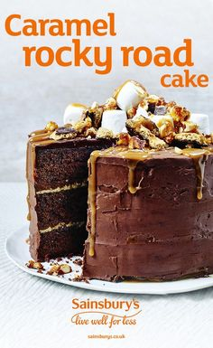 Get into baking mode this Mother's Day and treat mum to this chocolatey caramel rocky road cake topped with caramel sauce, marshmallows and chocolate digestive biscuits.