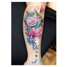 Breathtakingly beautiful floral leg tattoo done in the water color style by the incredible Lianne Moule.....the colors of the rose are gorgeous