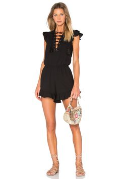 Endless Rose Lace Up Ruffle Romper in Black | REVOLVE