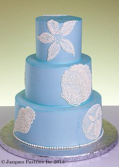 Beach wedding cake I don't really care for the blue. Crisp White Would be nicer.