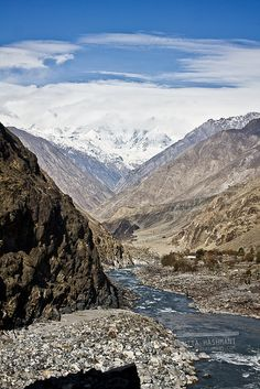 River in Gilgit, Pakistan. Gilgit Valley is located in district Gilgit, with namesake regional and divisional capital in Gilgit-Baltistan, in northern Pakistan. The Gilgit River flows here.