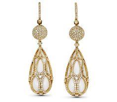 GILDED SILENCE EARRINGS  $14,000.  18k yellow earrings, tear drop shaped white onyx, over 4 cts in diamonds.