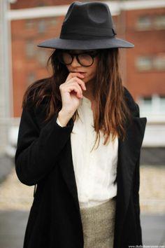 Black hat black coat, looking cool.