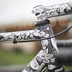 This road bike by @spooncustoms really needs to be seen to be fully appreciated: Featuring over thirty hours of artwork by @xsamdunnx inspired by Jeff Phillips Ciamillo brakes and wheels by @augustwheelworks it's one of the most eye-catching bikes of the year. Full story on Cycle EXIF today. @jwphotographer by cycleexif