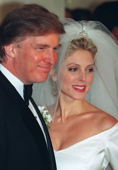Donald Trump and Marla Maples pose for photographers following their wedding ceremony in New York in December 1993.