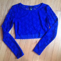 Blue lace top..crop top Blue lined lace, showing belly with long sleeves.  New without tags Forever 21 Tops Crop Tops