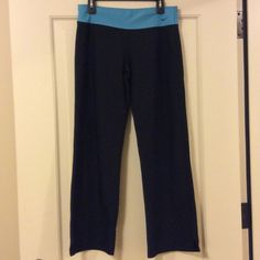 """Nike Dri Fit Black Workout Pants, Size Large Short Excellent condition Nike Dri fit workout pants, size large short. Black pants with a light blue waistband and small slits at the legs to go comfortably over tennis shoes. Worn just a few times. 38"""" long, 29 1/2"""" inseam, and 11"""" rise. Nike Pants Track Pants & Joggers"""