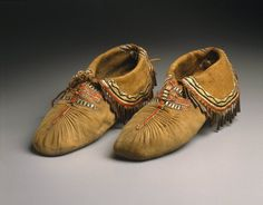 Eastern, Sioux (Native American). Pair of Puckered Moccasins, early 19th century. Smoked buckskin, deer skin, deer hair, porcupine quills, copper, 4 x 11 in. (10.2 x 27.9 cm). Brooklyn Museum, Henry L. Batterman Fund and the Frank Sherman Benson Fund, 50.67.20a-b. Creative Commons-BY (Photo: Brooklyn Museum, 50.67.20a-b_SL1.jpg)