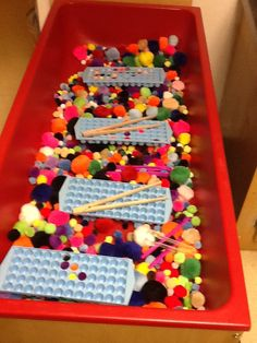 """Pom Poms sensory table that leads to great fine motor practice, sorting…"