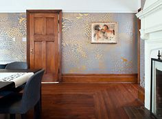 simply gorgeous hand-painted walls. gold paint on slate grey is so luxe